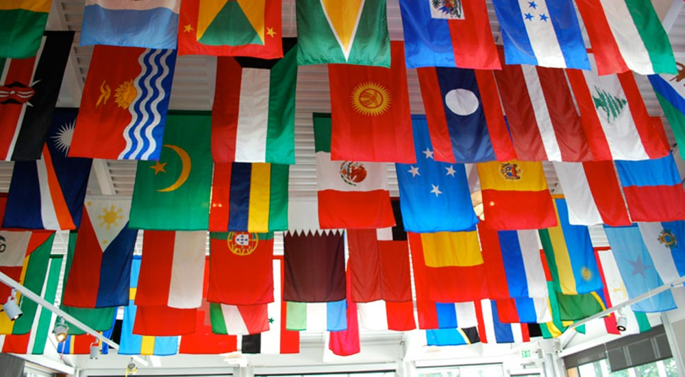 Multiple nations' flags hanging from ceiling